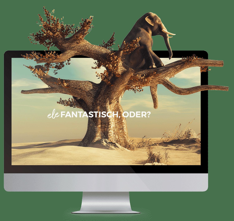 Monitor mit einer kreativen Webseite aus der ein Elefant aus dem Monitor entweicht